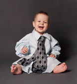Happy baby boss wearing over sized suit — Stock Photo