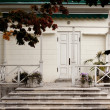 White house with verandah, white railings — Stock Photo #14177424