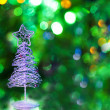 Christmas tree on green background — Stock Photo