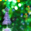 Christmas tree on green background — Stock Photo #21291171