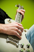 Close up of an electric guitar being played. — Stock fotografie