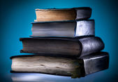 Old books, blue light background — Zdjęcie stockowe