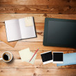 Stock Photo: Workspace with coffee cup, tablet pc, instant photos, notebook