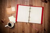 Area di lavoro con la tazza di caffè e notebook — Foto Stock