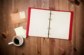 Workspace with coffee cup and notebook — Stockfoto