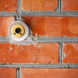 Old doorbell on the brick wall — Stock Photo