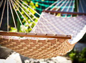 Hammock hanging in the sunny yard — Stock Photo