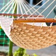 Stock Photo: Hammock hanging in sunny yard, close up photo