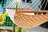Hammock hanging in the sunny yard, close up photo — Stock Photo