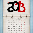 November 2013 Calendar, open old notepad on blue paper — Stock Photo