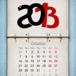October 2013 Calendar, open old notepad on blue paper - Stock Photo