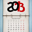 September 2013 Calendar, open old notepad on blue paper — Stock Photo #13272363