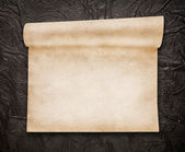 Aged scroll paper, old leather on background — Stock Photo