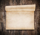 Aged scroll paper, old wood on background — Stock Photo