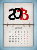 January 2013 Calendar, open old notepad on blue paper — Stock Photo