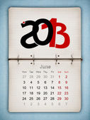 June 2013 Calendar, open old notepad on blue paper — Stock Photo