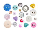 Various sewing buttons with a thread — Stock Photo