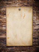Old paper on the wood background — Stok fotoğraf
