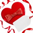 Red heart with red bow, ribbons and blank tag, isolated on white — Stock Photo