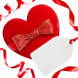 Stock Photo: Red heart with red bow, ribbons and blank tag, isolated on white