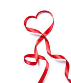 Red heart ribbon, on white background — Stock Photo