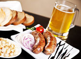 Grilled sausage with beer — Stock Photo