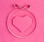 Hand made paper heart on pink kraft paper as background. Greetin — Stock Photo