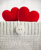 Two red hearts in wool pocket — Stock Photo