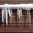 Stock Photo: Icicles on Log Cabin