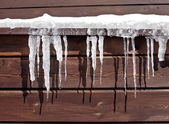 Icicles on Log Cabin — Stock Photo