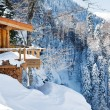 Wooden ski chalet in snow, mountain view — Stock Photo #22435853