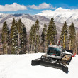 Snowplow, montains on background - Stock Photo