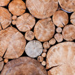Stacked logs, wooden background — Stock Photo