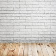 Room interior with white brick wall and wood floor background — Stock Photo