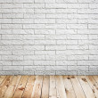 Room interior with white brick wall and wood floor background — Stockfoto