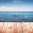 Empty wooden table with blur sea on background. — Stock Photo