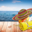 Wooden table with beach items, blur sea on background, template — Stock Photo