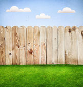 Wooden fence in a green grass, template design — Stock Photo