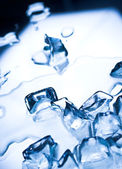 Abstract background with ice cubes over wet glass — Stock Photo