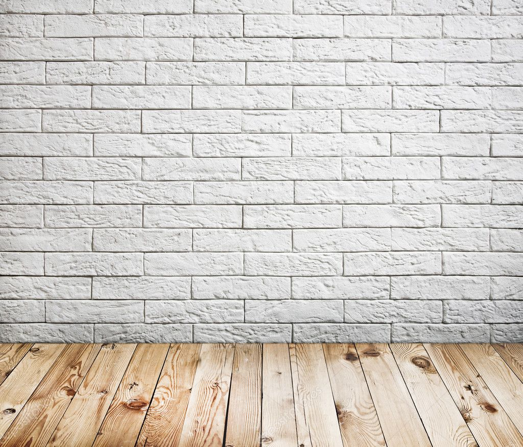 White Floor with Brick Wall Background