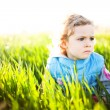 Adorable little girl taken closeup outdoors in summer — Stock Photo