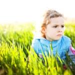 Adorable little girl taken closeup outdoors in summer — Stock Photo #25736115