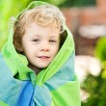 Adorable little girl taken closeup outdoors in summer — Stock Photo #26761195
