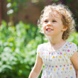 Adorable little girl taken closeup outdoors in summer — Stock Photo #26761199