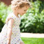 Adorable little girl taken closeup outdoors in summer — Stock Photo #26761213