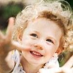 Adorable little girl taken closeup outdoors in summer — Stock Photo #26761223