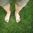 Feet relaxing in the grass — Stock Photo