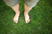 Feet relaxing in the grass — Photo