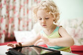 Cute little girl using tablet computer — Stock Photo