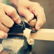 Old carpenter working with wood — Stock Photo